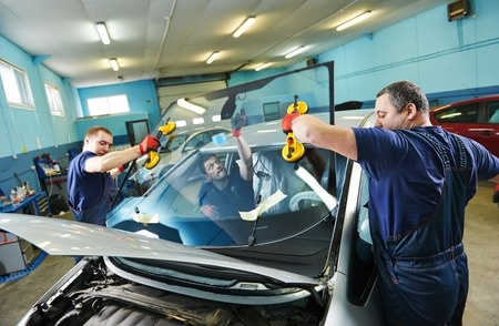 Employees holding front auto window
